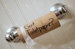 144839075-toilet-paper-empty-cardboard-toilet-paper-roll-on-spool-reading.jpg
