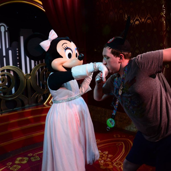 Kissing Minnie's hand