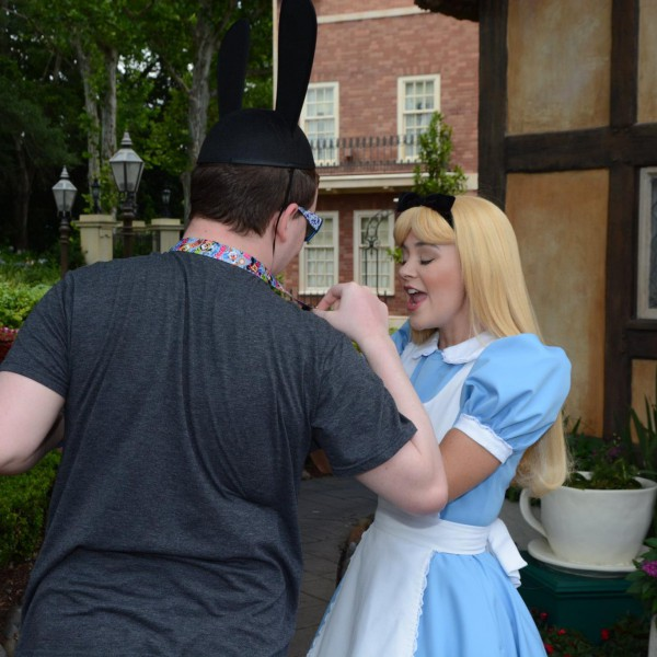 Showing Alice my Cheshire Cat Pin