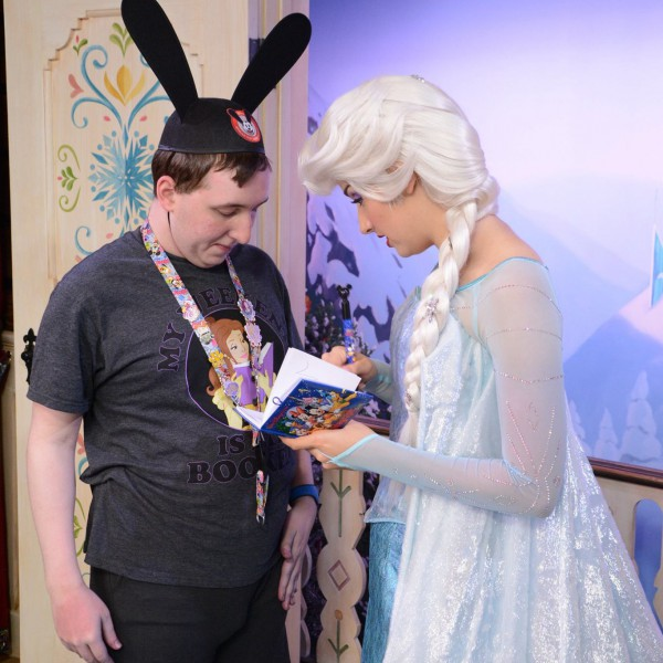 Elsa signing my autograph book