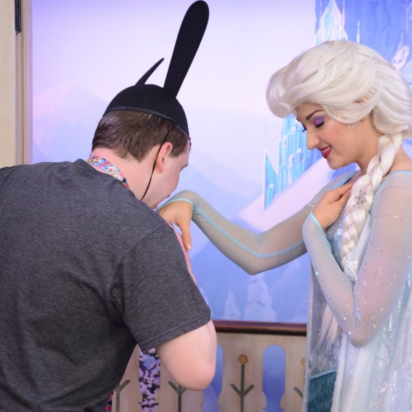 Kissing Elsa's hand