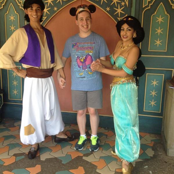 Holding Aladdin and Jasmine's hands