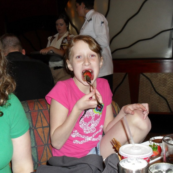 My little sister eating a Chocolate Strawberry